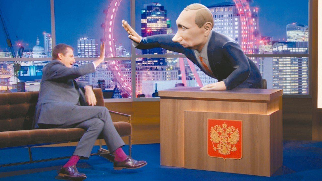 以普亭為造型的3D卡通人物(右)專訪英國前首相布萊爾發言人康貝爾(左)。 圖/摘...