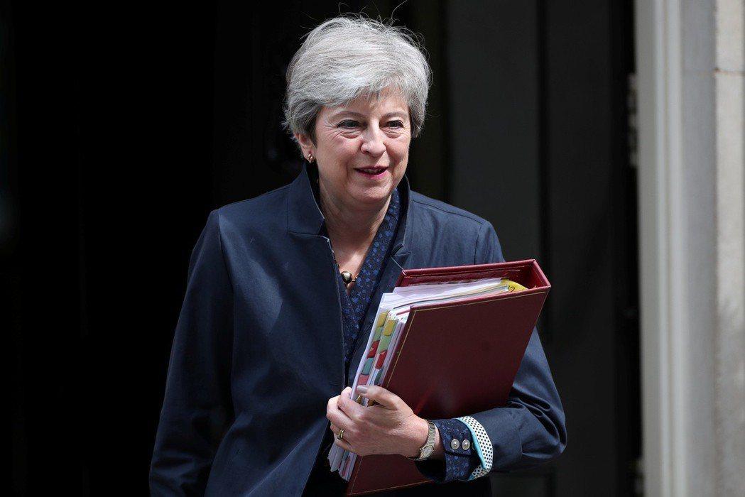英國首相梅伊7日辭去保守黨黨魁,現為看守總理。 (路透)