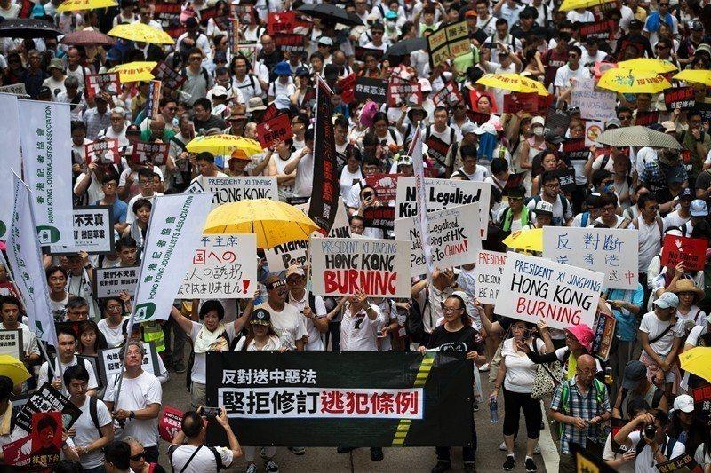 攝於6月9日,香港反中大遊行。 圖/歐新社