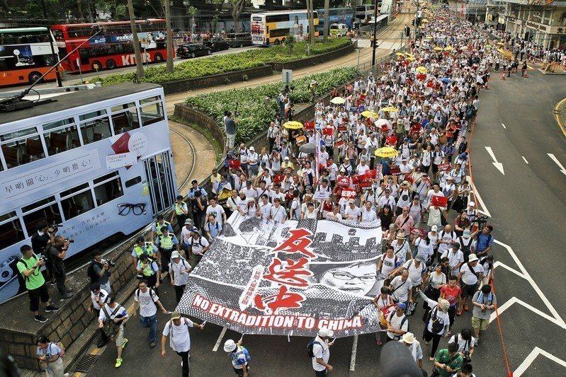 攝於6月9日,香港反中大遊行。 圖/美聯社