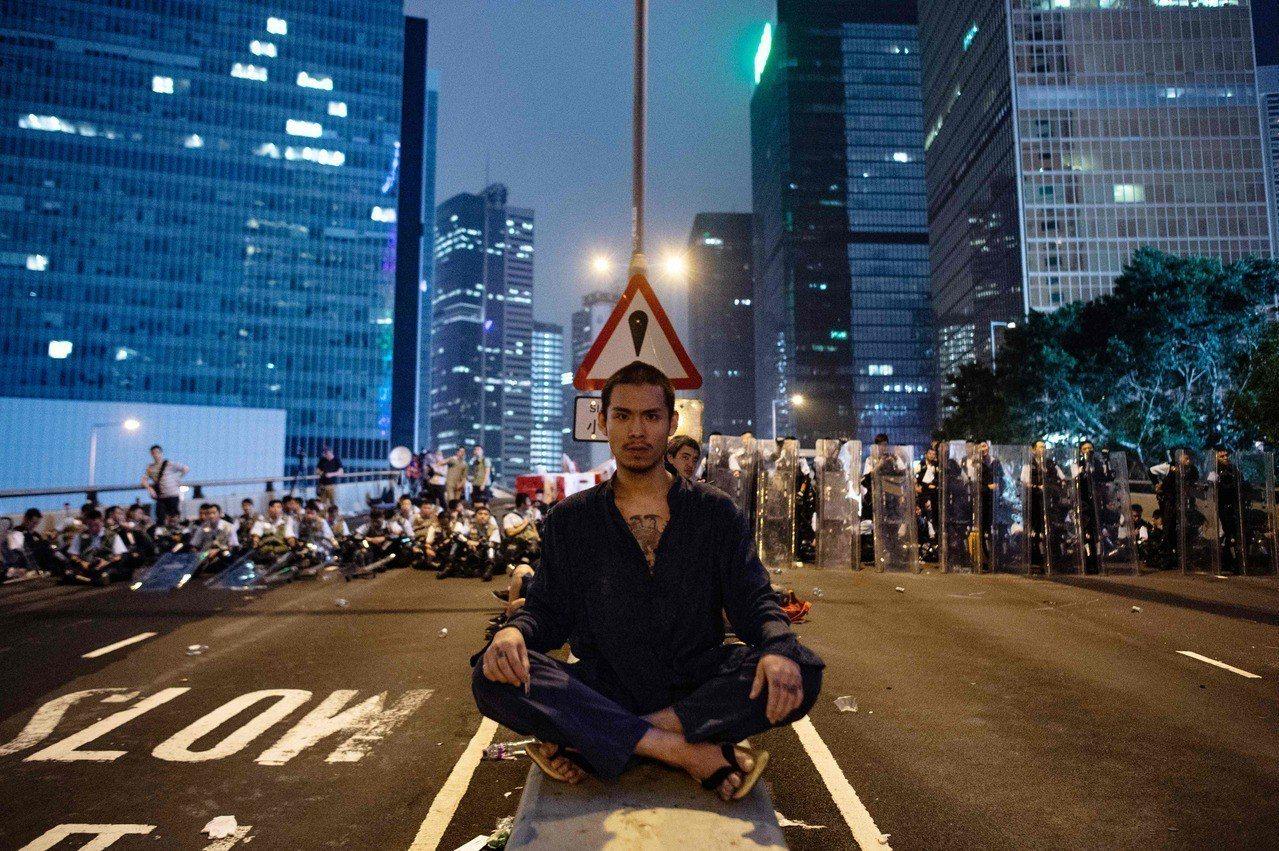 北京將12日反對逃犯條例二讀的香港民眾示威定性為「暴動」。(法新社)