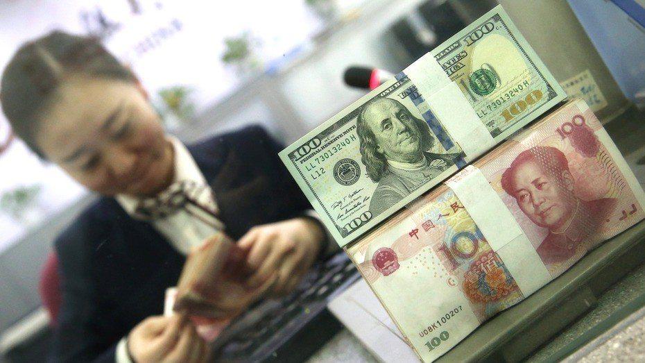 美銀美林認為中美若「無協議+貿易戰」 人民幣明年底貶至7.77。圖/經濟日報