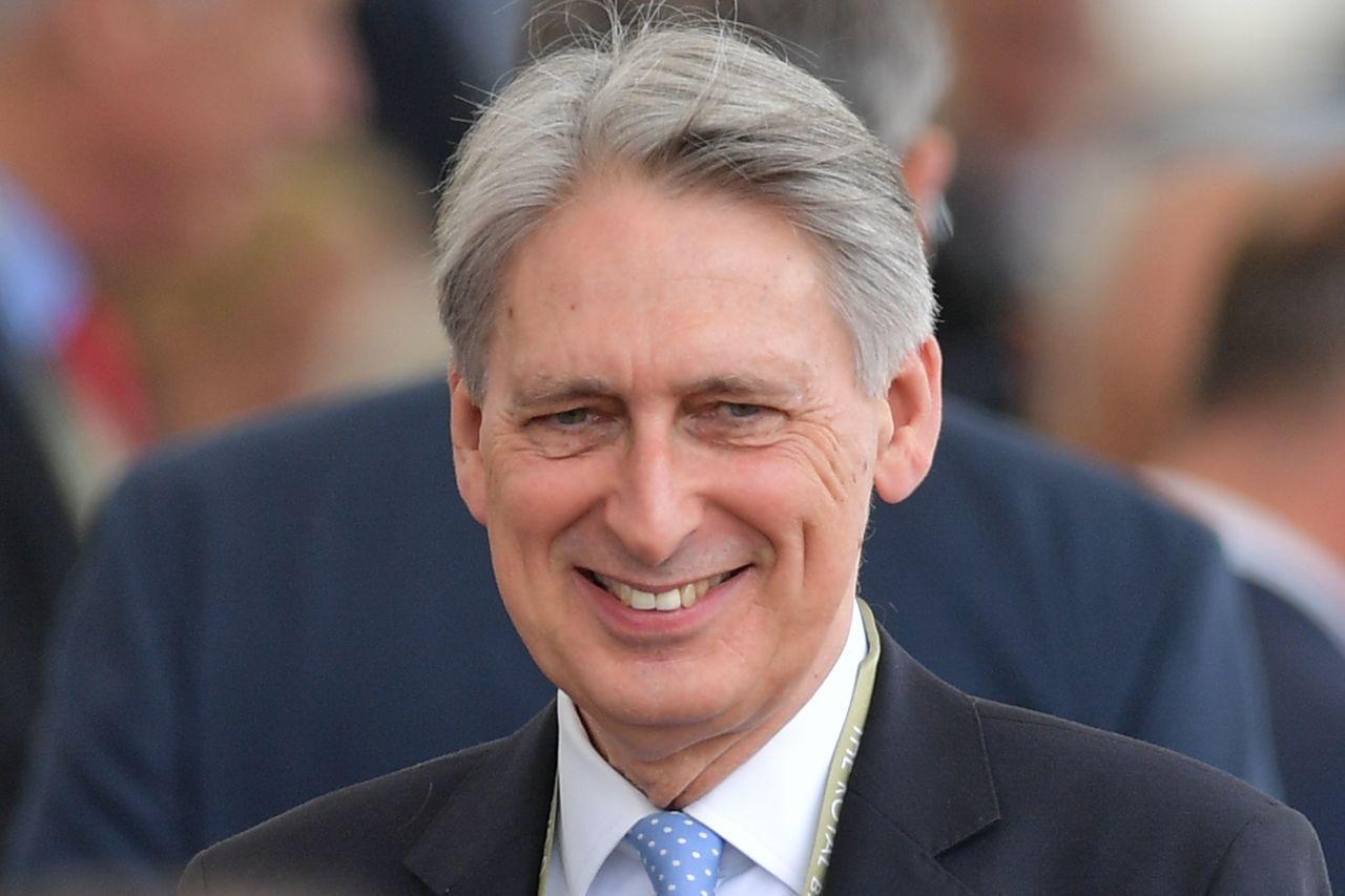 英國財政大臣韓蒙德今天(17日)將啟動「滬倫通」。法新社