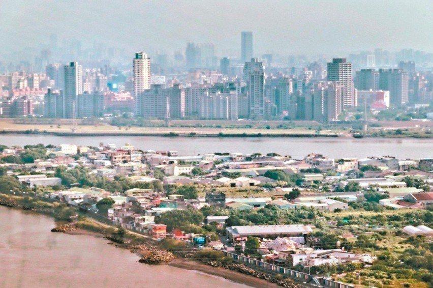 社子島位在基隆河與淡水河交會處,1970年被畫為滯洪區,禁、限建近半世紀。 圖/...