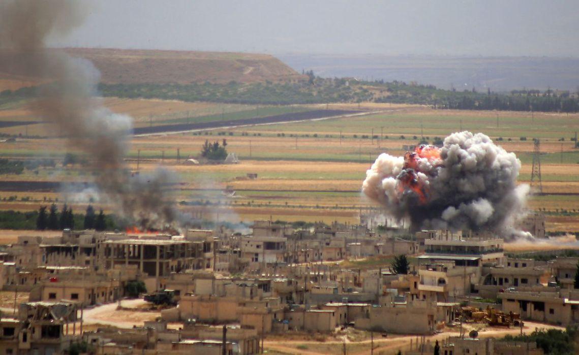 圖為政府軍對伊德利卜反抗軍的空襲。 圖/法新社