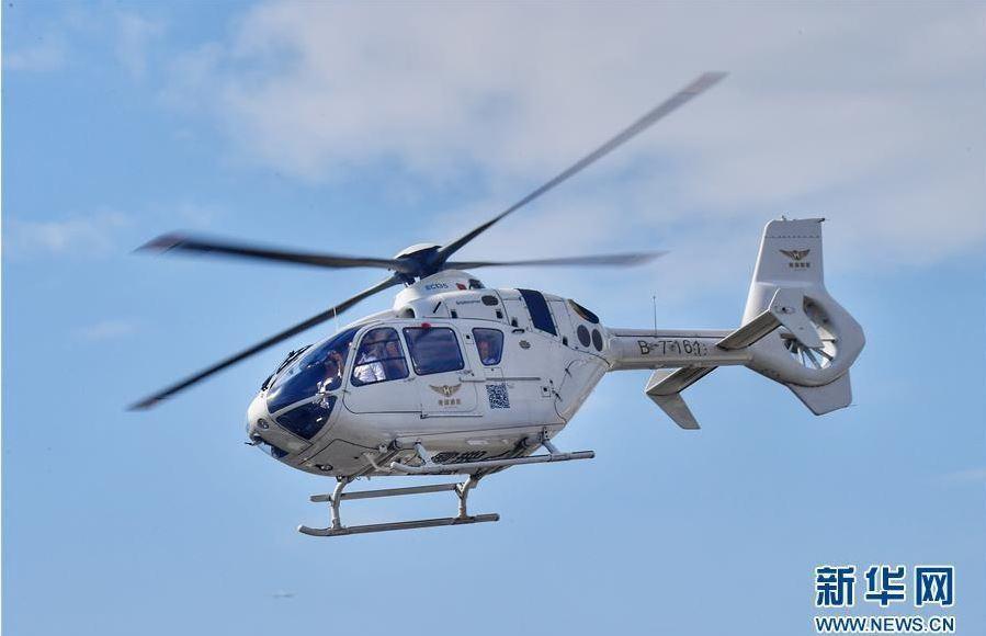 空客135雙引擎直升機首航深圳到香港直升機跨境航線15分鐘可達。取自新華網