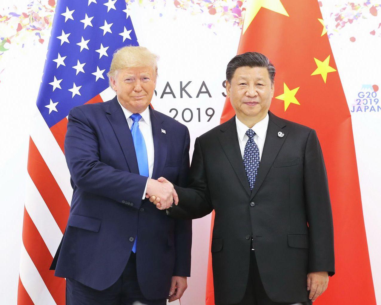 川普與習近平在G20峰會碰面。 (新華社)