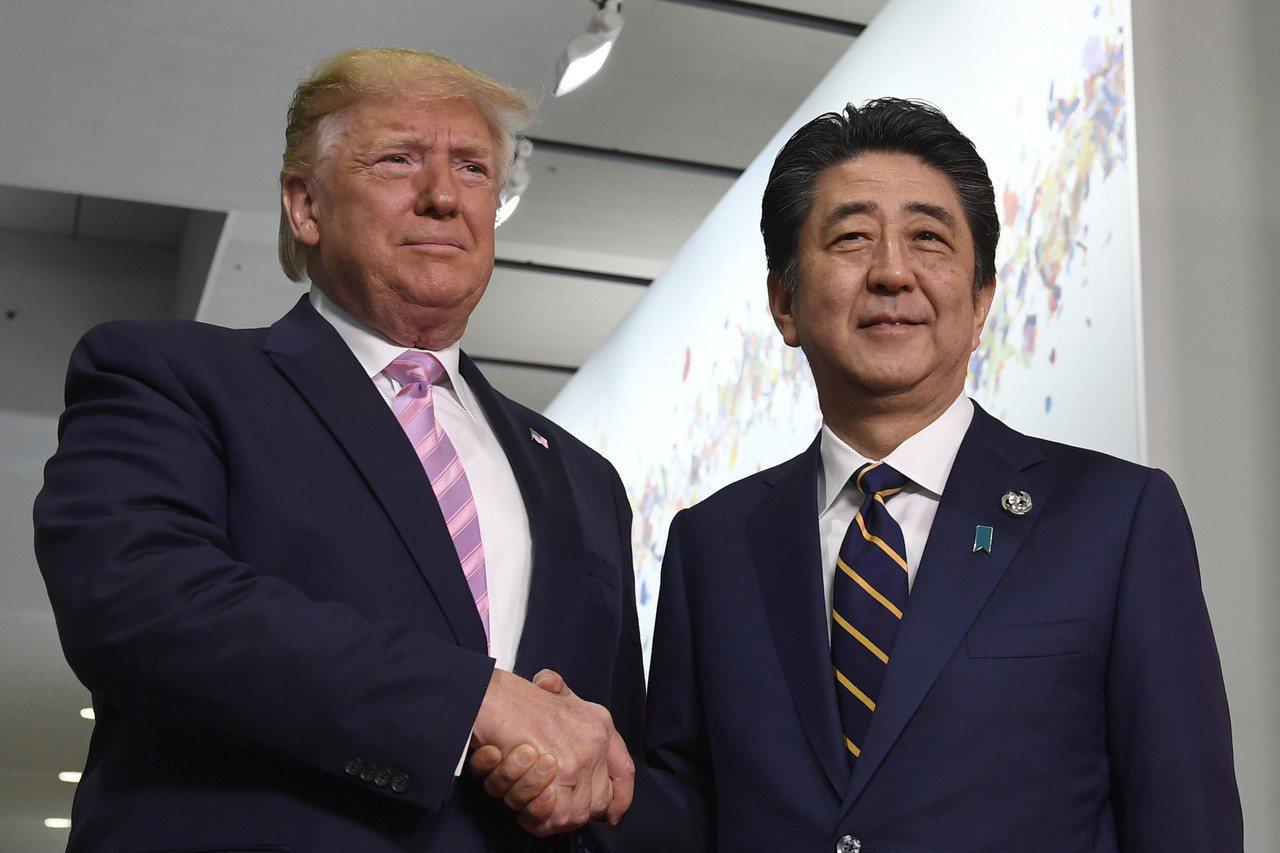 Trump G20 President Donald Trump, left, ...