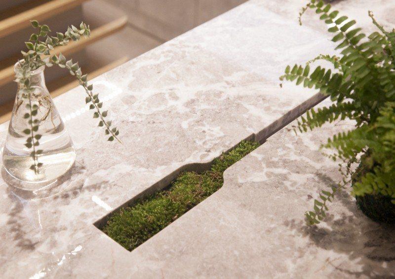 歐萊德門市的「水循環」體驗區,消費者試用產品後的水,會經由排水裝置灌溉到獨創的洗...