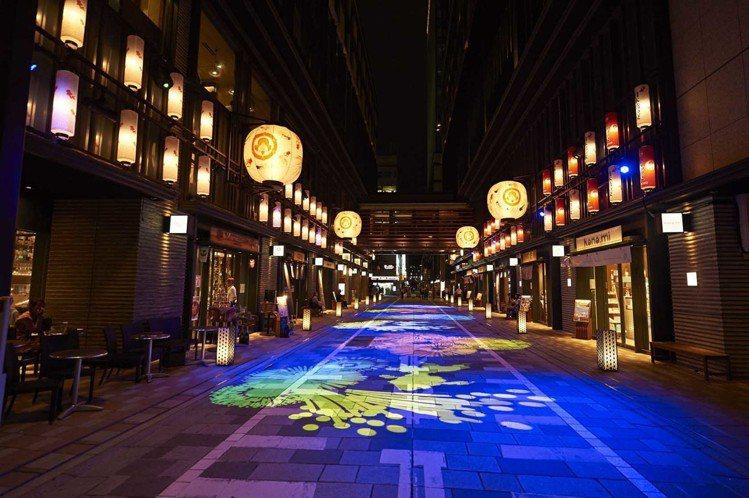 由碩大金魚提燈搭配數位光影藝術的「金魚大提燈隧道」。圖/主辦單位提供
