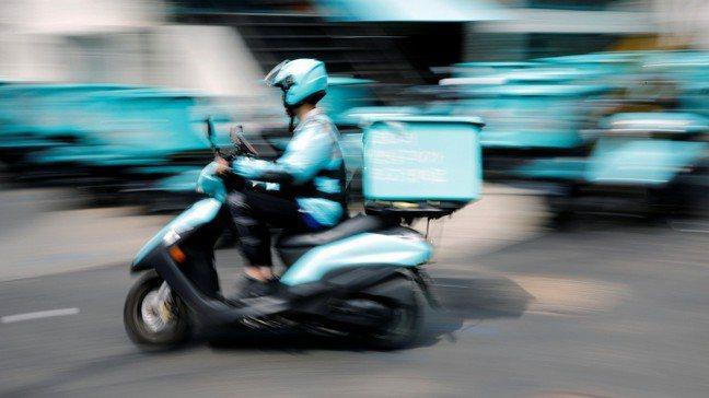 南韓Baemin Rider員工在首爾以機車送餐。  路透社