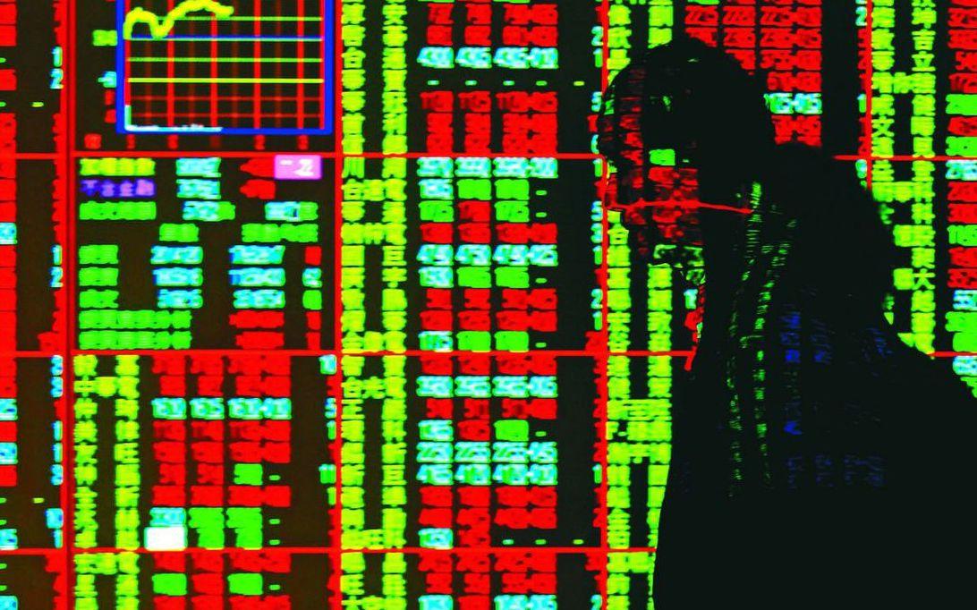 台股今日開低震盪走低,主要受到美中貿易戰的不確定因素影響。圖/聯合報系資料照片