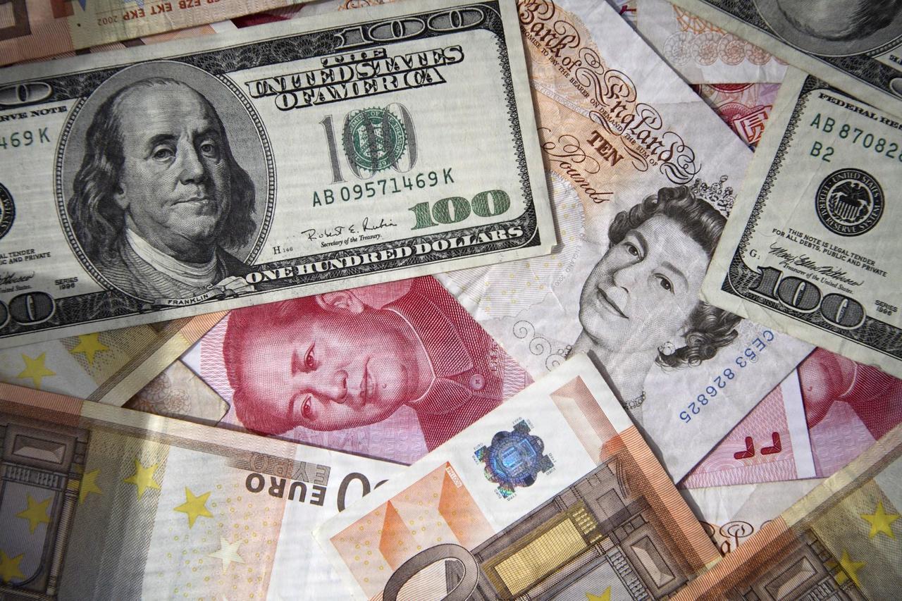 近期情勢轉變,新台幣與人民幣開始呈現高度相關性。歐新社