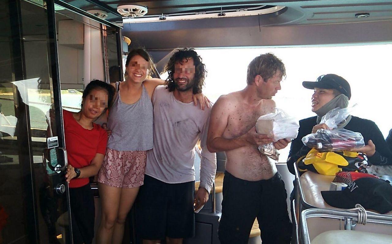 香港籍遊艇上的男女在電力修復後,高興得向海巡人員道謝。記者林保光/翻攝