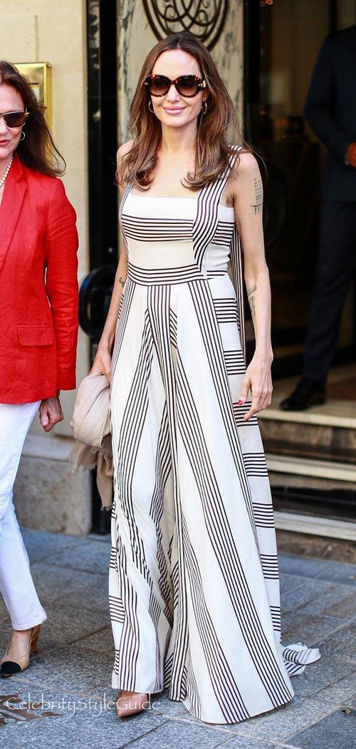 安潔莉娜裘莉身穿Loro Piana的Camille連身裙,搭配路易威登Pari...