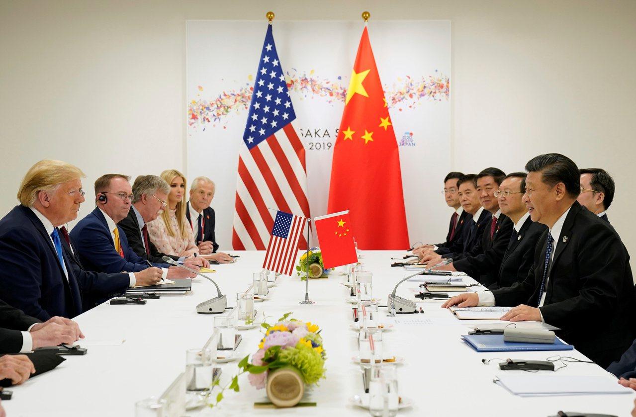 美中貿易戰雖在近期再次休兵,但雙方談判仍陷入僵局。圖為6月底G20峰會期間,兩國...