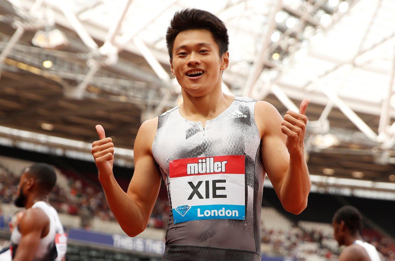 中國大陸短跑名將謝震業200公尺決賽飆出19秒88奪金,改寫亞洲紀錄。 路透