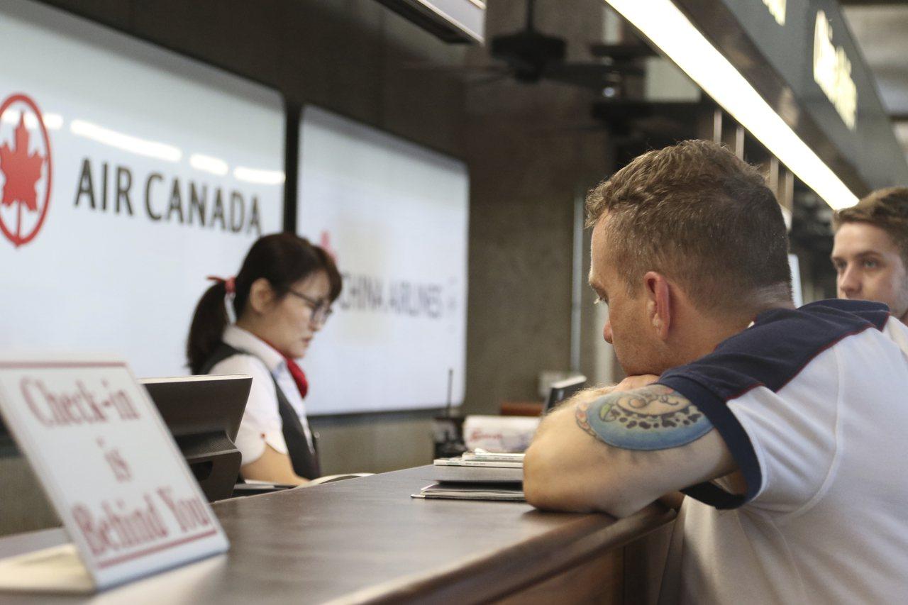 加拿大航空公司(Air Canada)安排兩位彼此不認識的旅客住在一個房間。圖為...