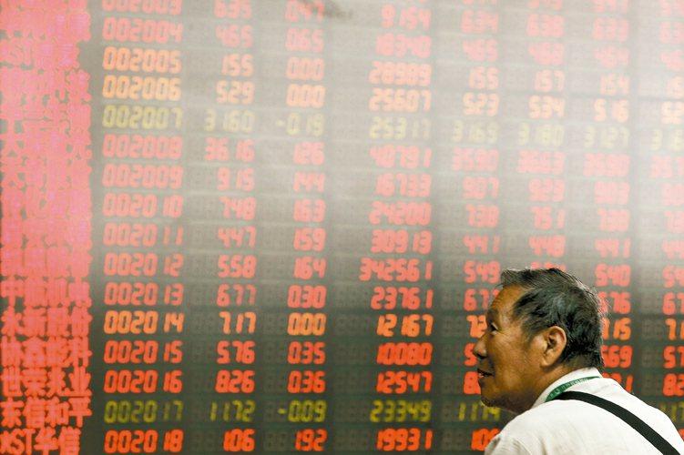 法人表示,隨人行執行寬鬆政策,外資「活水」進入中國資本市場將更便捷。 美聯社
