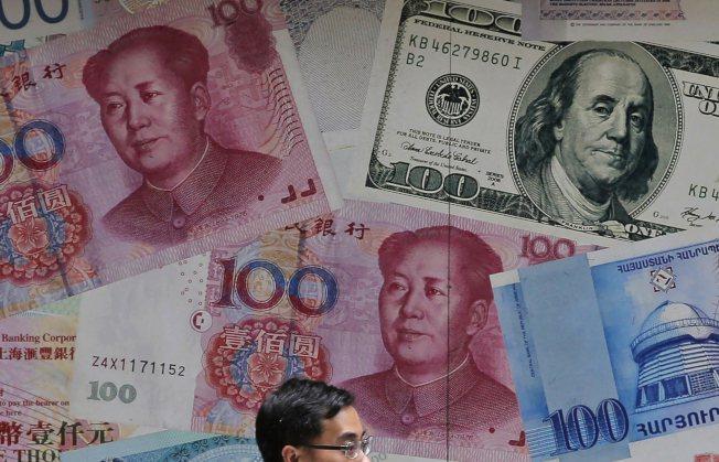 在北京和華盛頓之間的貿易戰再次升級之後,人民幣兌美元匯率跨越了一個備受密切關注的心理關卡。 美聯社