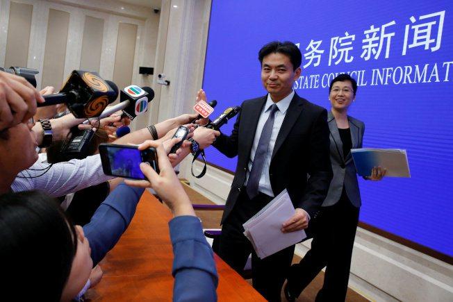 中共港澳辦發言人楊光出席記者會回應香港問題。路透