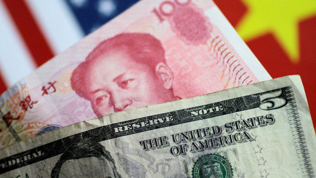 人民幣對美元匯率本周「破7」,引起市場一陣驚慌。。路透