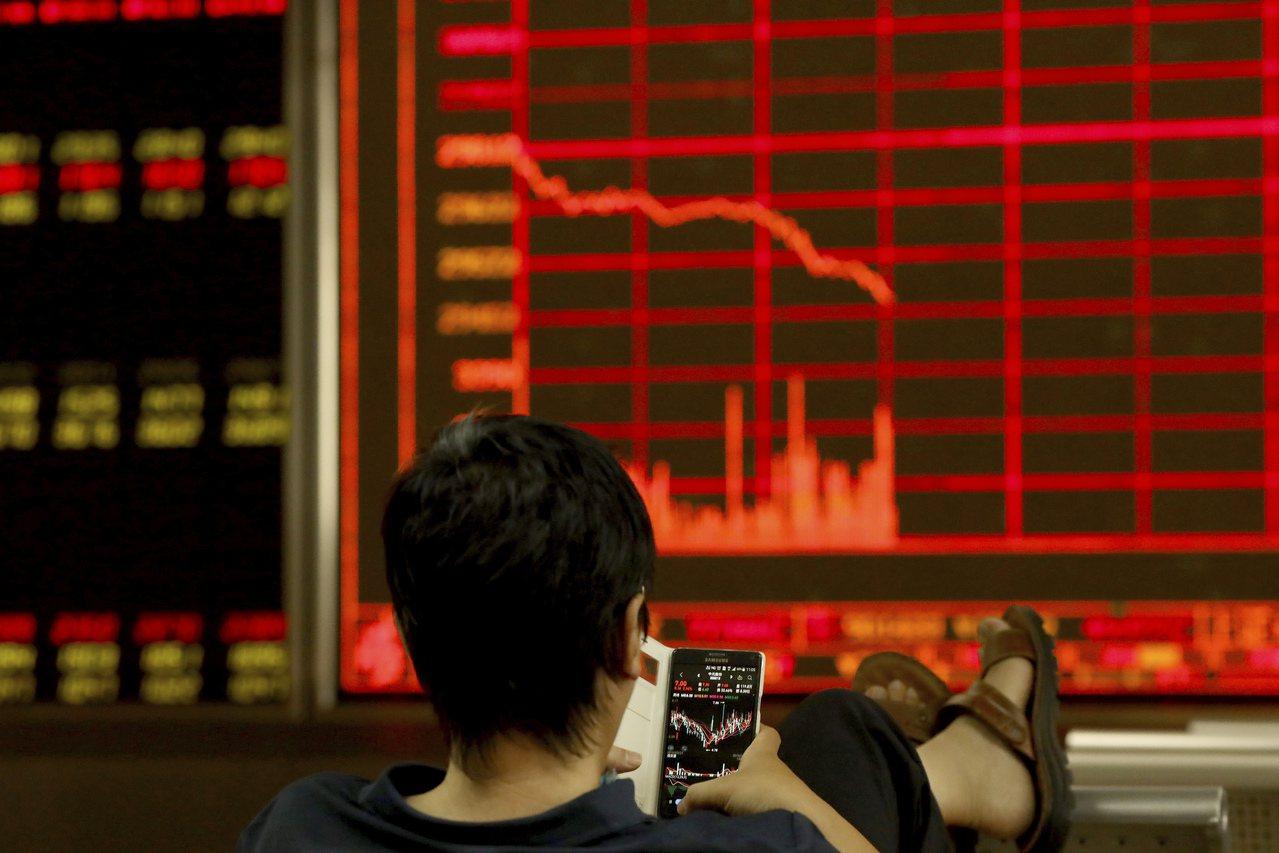 A股「入摩」邁入第二階段,納入因子8月底將從10%提高至15%。 美聯社