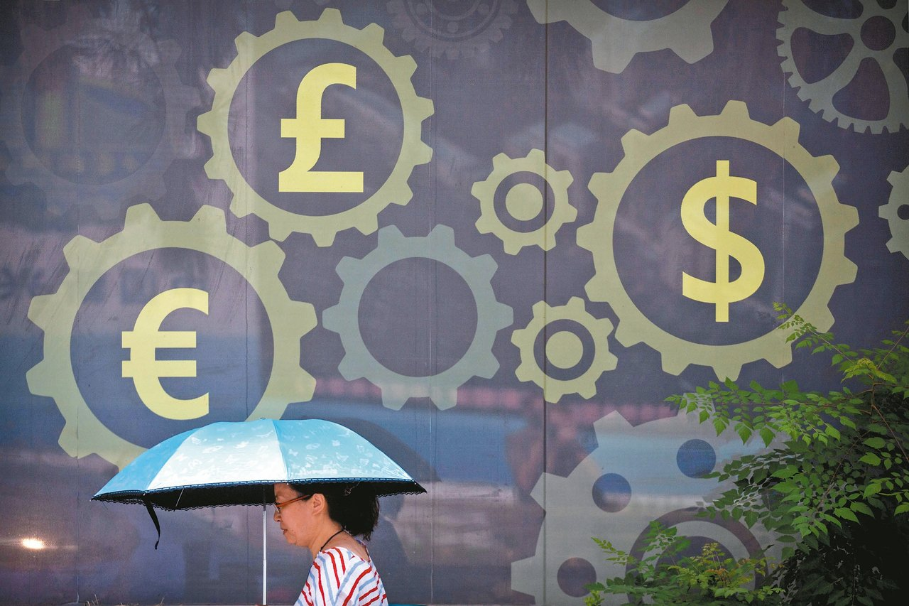 人民幣匯率回穩,但作為與美國進行貿易戰武器的威力已經展現。圖為北京一處銀行的外牆...