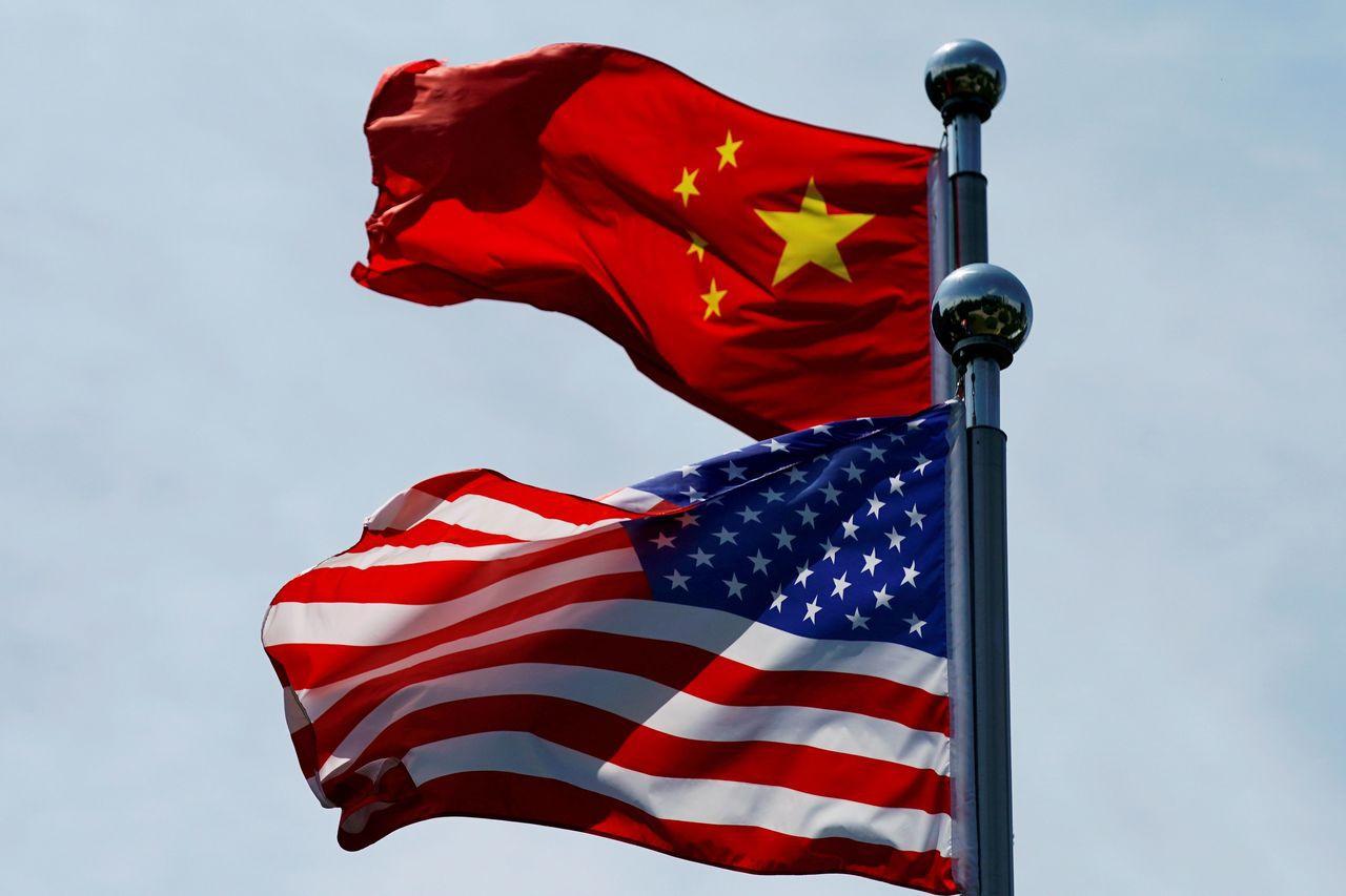 美中貿易戰抑低了全球經濟成長動能。路透