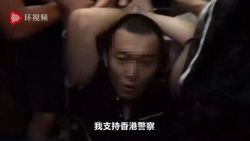 根據環球網上的影片,環球網記者付國豪13日在香港機場遭抗議群眾綁住手腳時高喊,「...