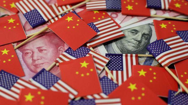 基於美元的全球霸主地位依然穩故,大陸操縱人民幣匯率未必能獲得好處。圖/路透