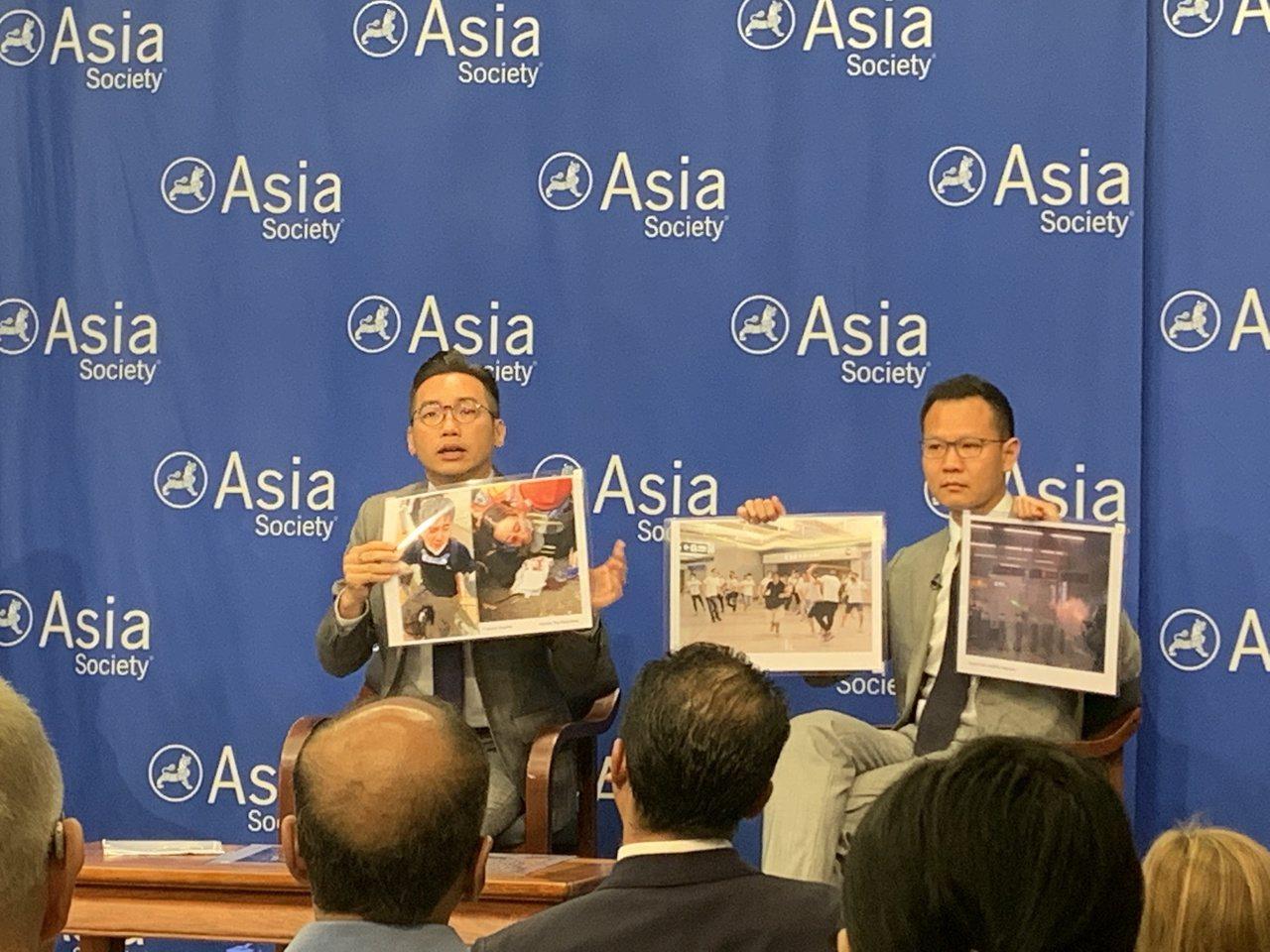 楊岳橋、郭榮鏗稱香港警方暴力執法,並指示相關照片。世界日報記者/和釗宇攝影
