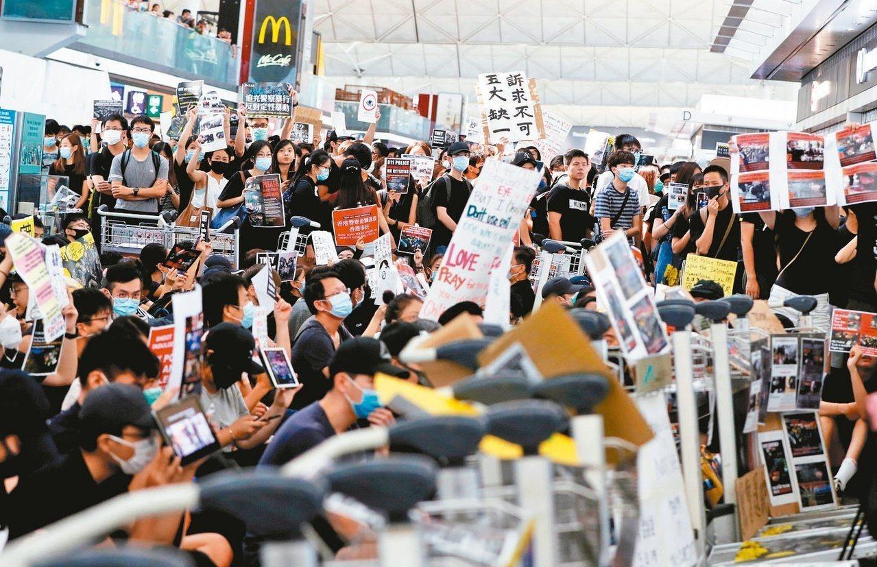 學者:香港動亂看起來很糟糕,從長遠看是好事。圖/世界日報提供