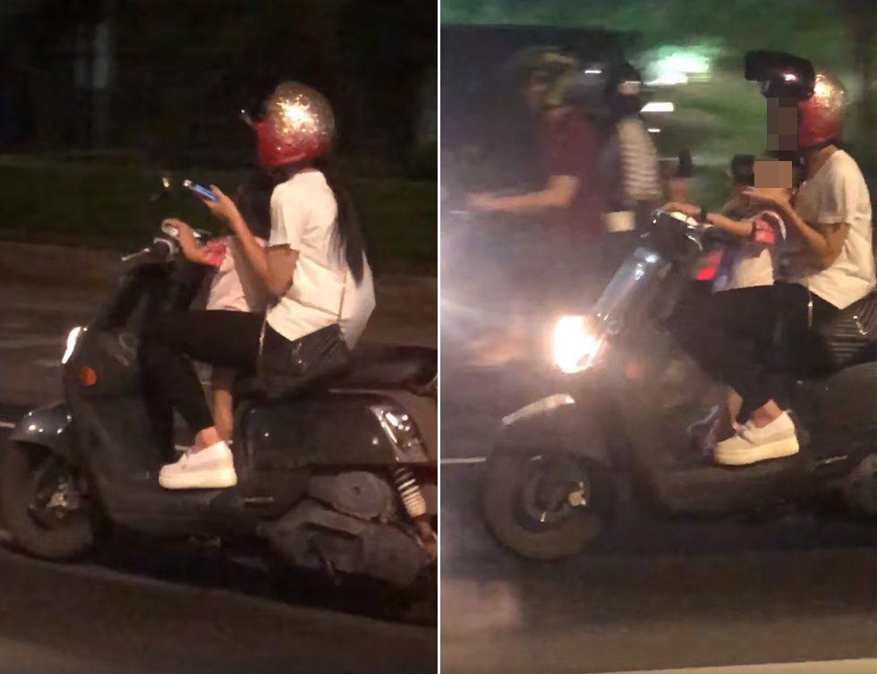 有民眾在路上目睹一名年輕女子單手騎機車還邊滑手機,前面腳踏板上還站著一名沒戴安全...