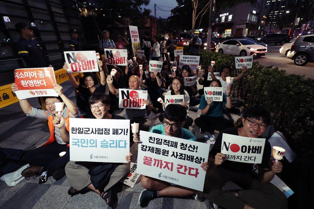 「只要日本撤銷對韓國的經濟報復、尊重韓國政府與國民,就能夠重啟對話合作。」圖為2...