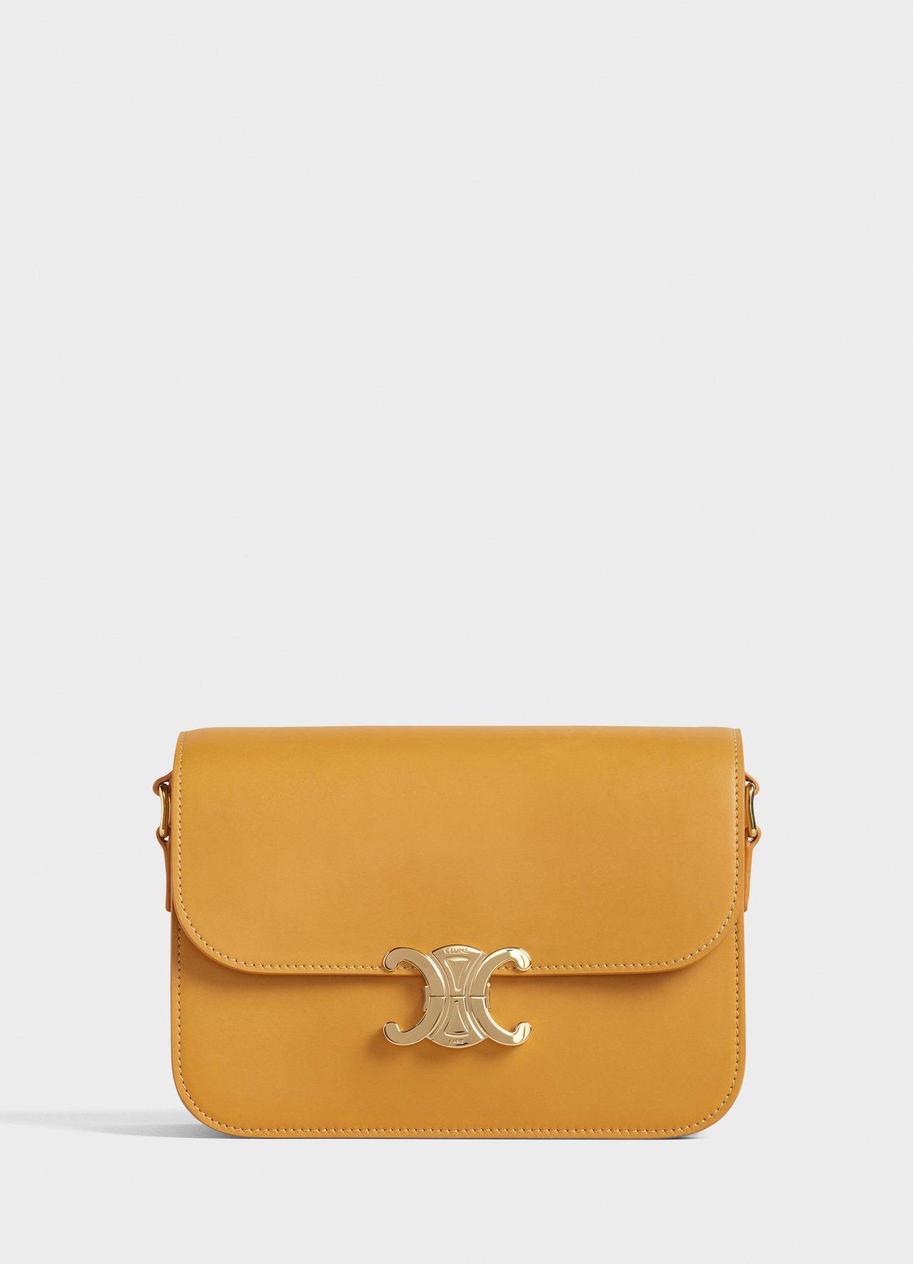 Triomphe赭黃色小牛皮中型肩背包,售價11萬5,000元。圖/CELINE...