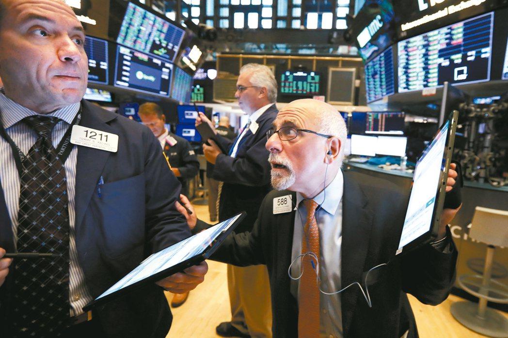 法人表示,線上支付、雲端商務產業火熱,帶動金融科技股表現。 美聯社