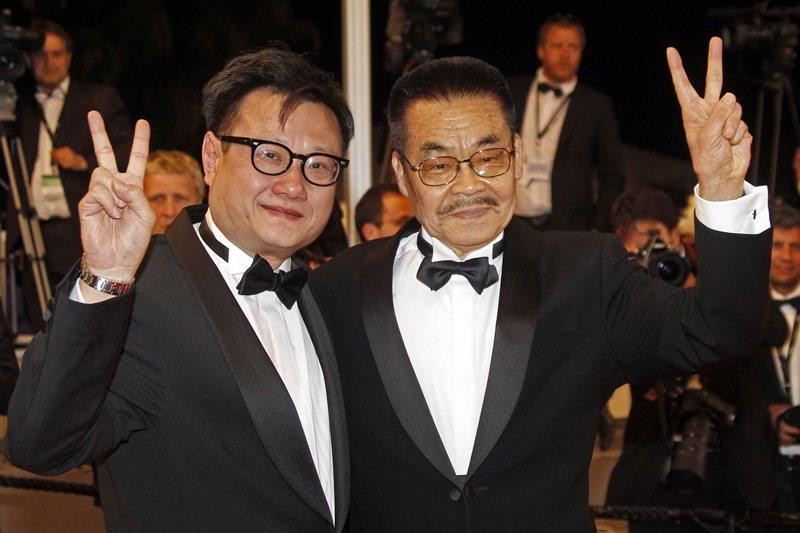 邱金海(左)執導的《昭和感官物語》呈現日本劇畫大師辰巳嘉裕(右)的真實與想像世界。攝於2011年法國坎城影展。 圖/美聯社