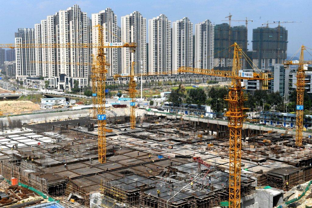 《彭博新聞》列出今年前4個月違約最多的公司,其中有多個集團業務涉足房地產。 圖/中新社