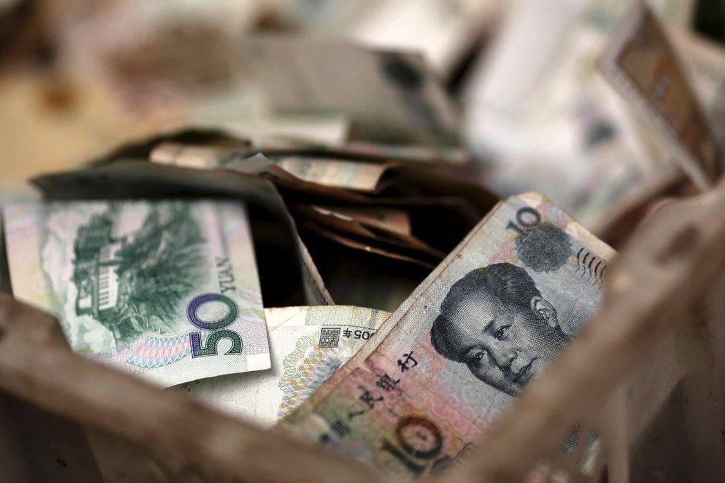中國央行緊急宣布,將再度降準,釋放9,000億人民幣資金。 圖/路透社