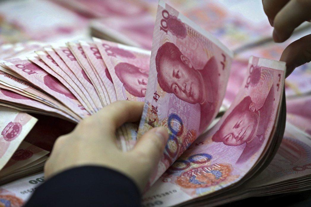 中國把「維持貨幣穩定」置於最高優先,以尋求於亞洲與其他地區建立其為經濟領袖的信譽與地位。 圖/美聯社