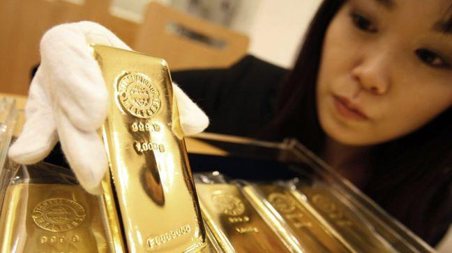 金價已漲到近六年高點,中國、俄羅斯等新興市場國家央行買黃金的胃口卻未稍減。圖/路...