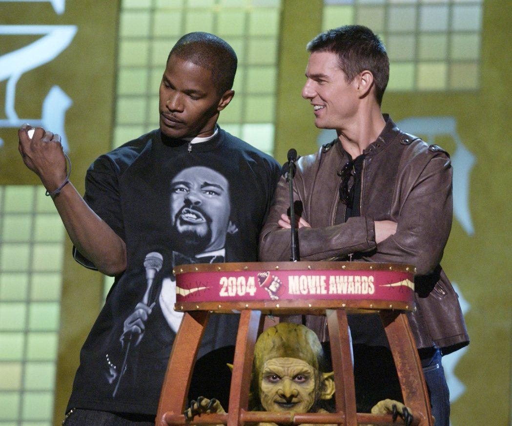 傑米福克斯與湯姆克魯斯為了宣傳「落日殺神」曾一起跑頒獎活動。圖/路透資料照片