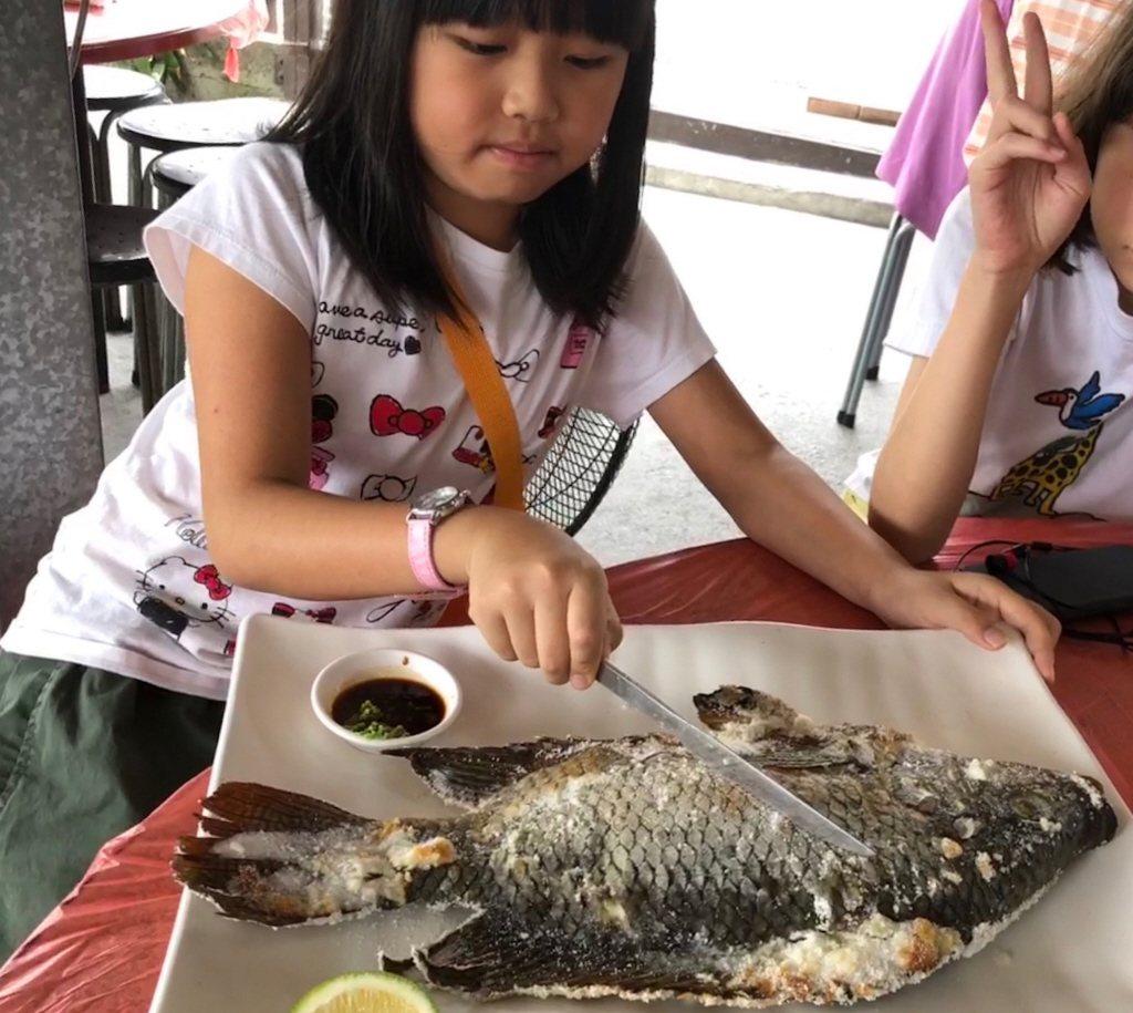 小朋友吃魚。聯合報系資料照/記者陳易辰攝影