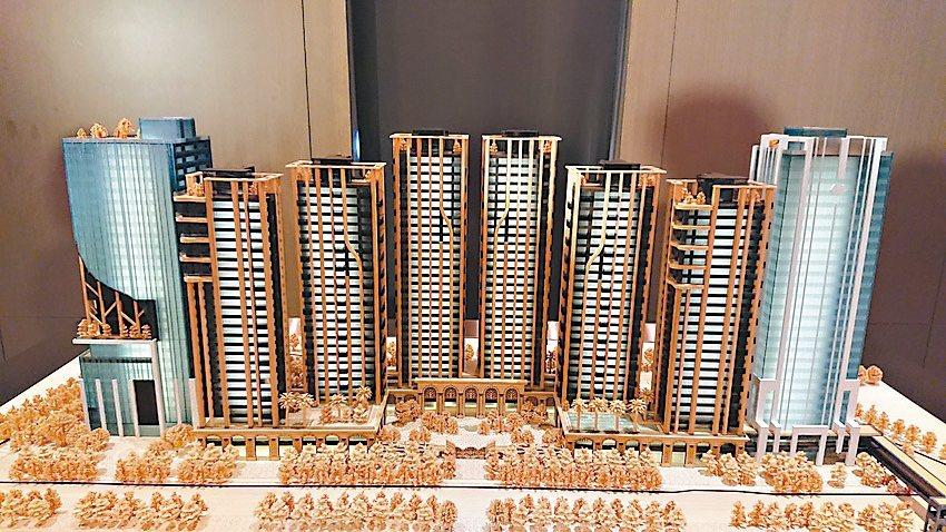 「世界明珠」規劃八棟大樓,其中兩棟商辦、六棟豪宅。商辦部分,右棟白色建物的13~...
