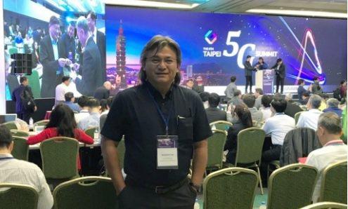 台灣新能智理李建成攝於 5G高峰會會場。 翁永全/攝影