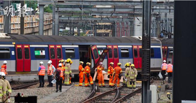 紅磡港鐵列車出軌,大批消防到場。(明報)