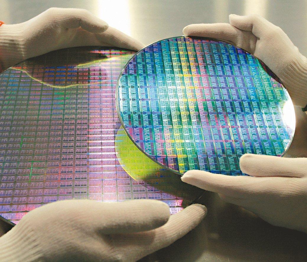 台積電傳出5奈米可望提前量產,激勵相關概念股逆勢走揚。 美聯社