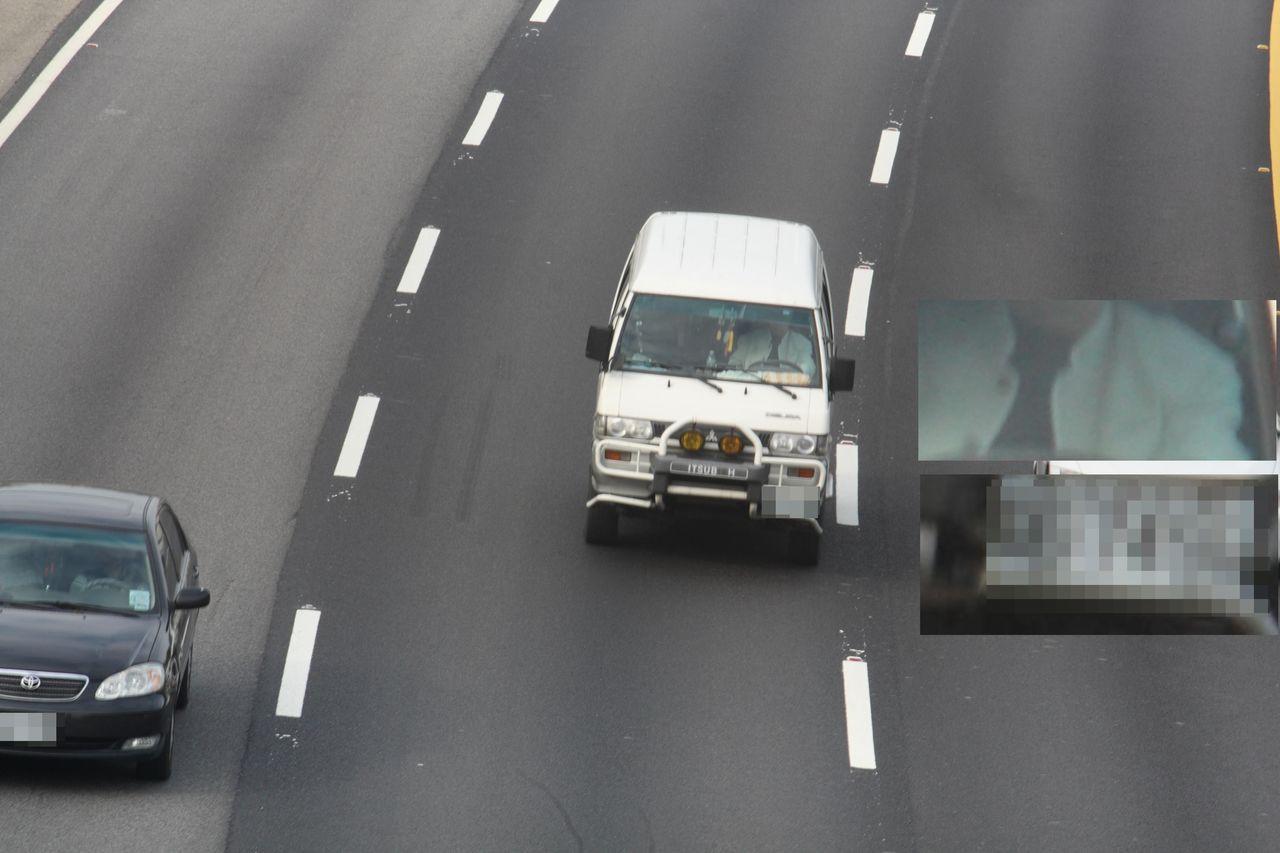 國道警方在跨越橋常拍到駕駛人未繫安全帶。圖/國道二隊提供