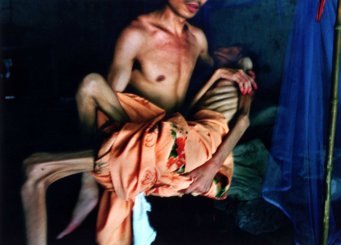 中國攝影師盧廣拍攝,2003年河南愛滋村的病人。 圖/路透社